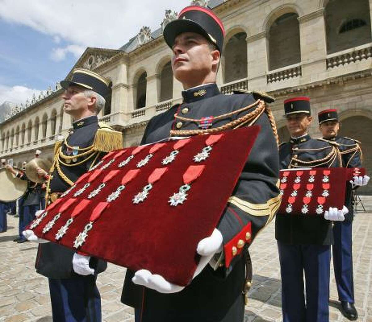 The French Republican Guard holds the Legion of Honor medals given to Clyde Combs and others during Friday's ceremony in Paris at Napoleon Bonaparte's tomb.