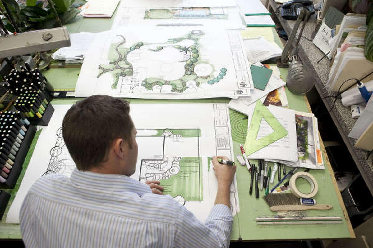 Landscape architect Jared Meinkowsky works on a design at A.J.'s Landscaping & Design.