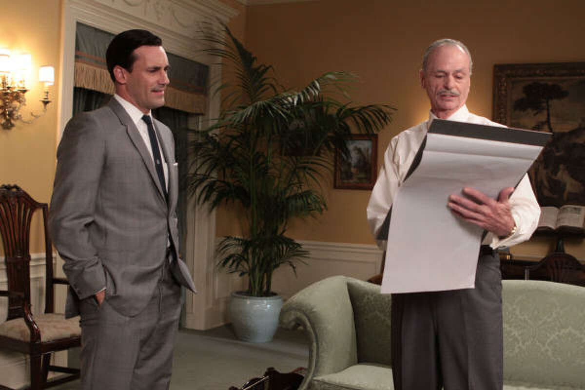 AMC PITCHING: Don Draper (Jon Hamm, left), and Conrad Hilton (Chelcie Ross) go over an ad for the hotelier on Mad Men.