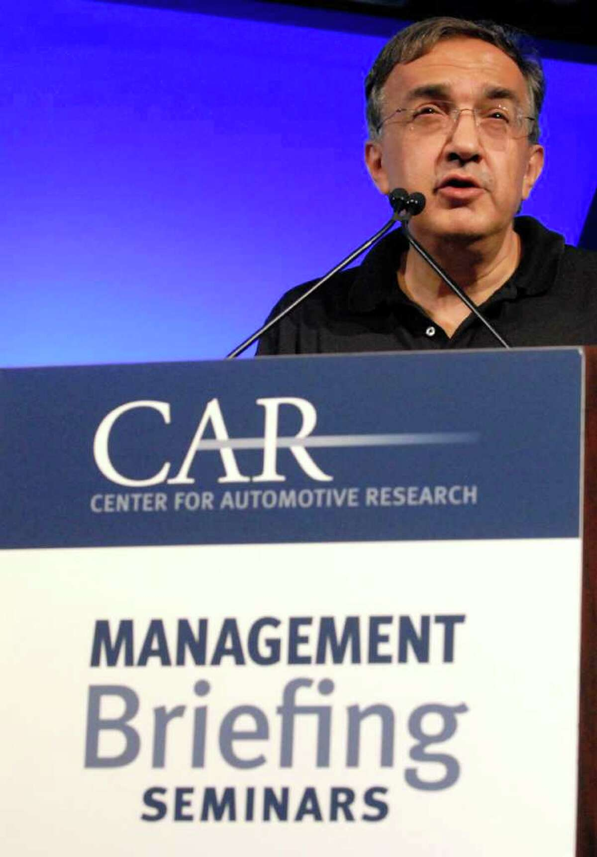 Chrysler Group LLC's Chief Executive Officer Sergio Marchionne speaks to a morning session at the annual Center for Automotive Research's Management Briefing Seminar Wednesday, Aug. 3, 2011, at the Grand Traverse Resort and Spa near Traverse City, Mich. Marchionne, also head of Italy?s Fiat SpA, said changes to the internal combustion engine, and not electric or hydrogen fuel cell technology, will be the answer to meeting the standards. (AP Photo/ John L. Russell)