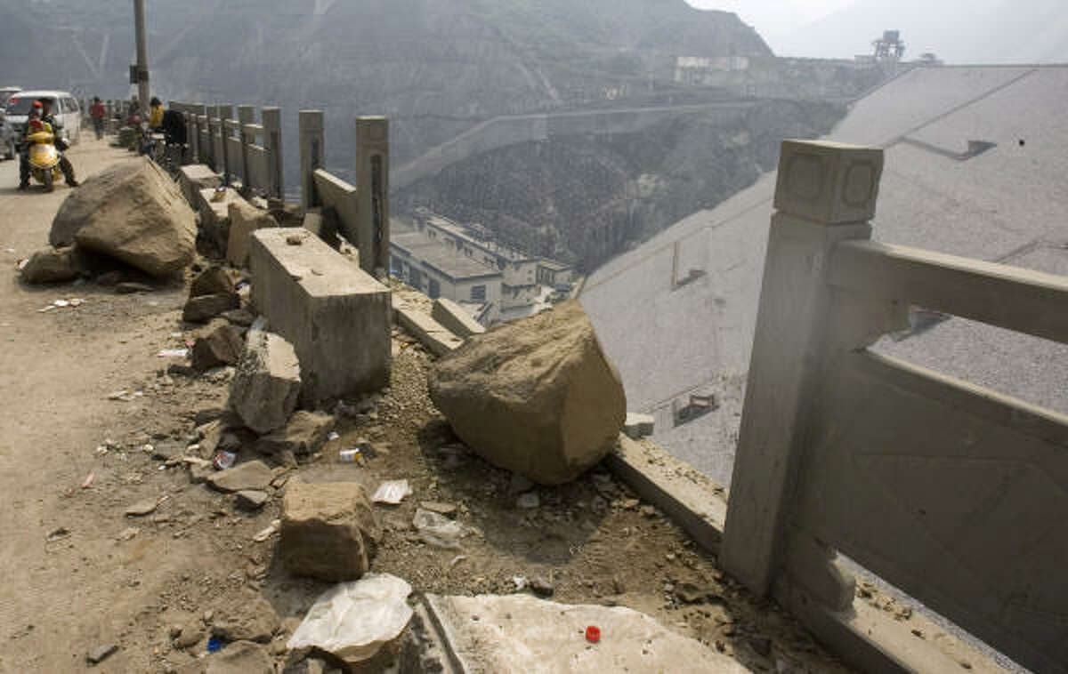 An earthquake caused damage next to the Zipingpu Dam in China's Sichuan province. Pressure from the reservoir may have started the disaster, which killed thousands, scientists say.