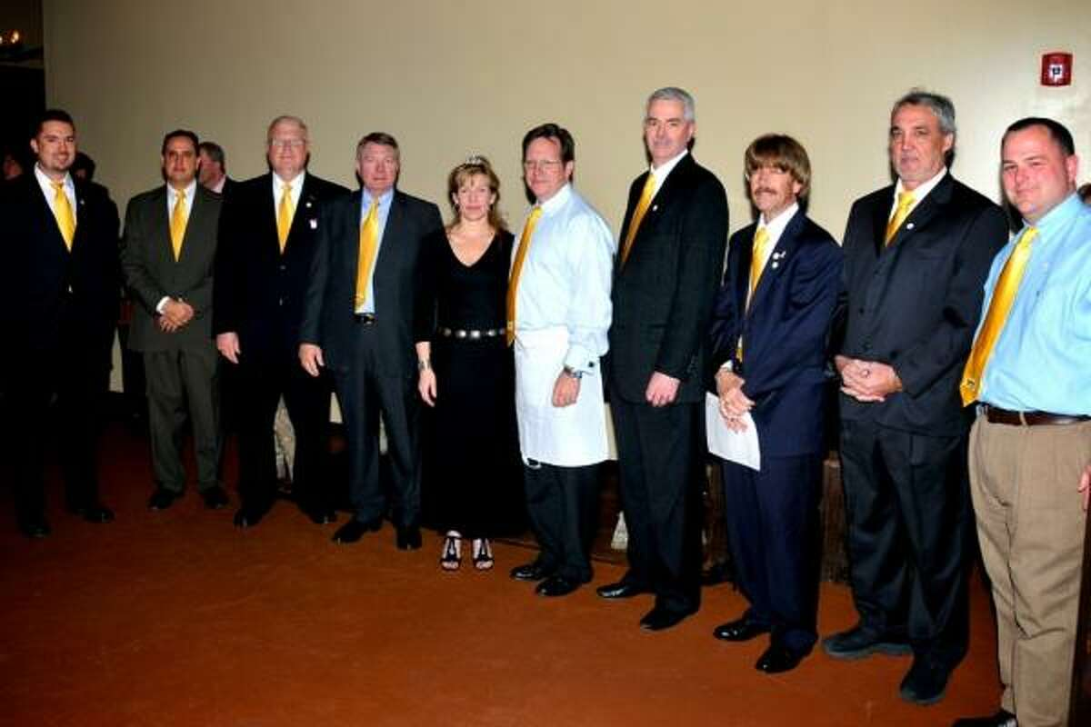 CORPORATE SPONSORS: Attending the Ties & Tiaras gala were, from left, Nick Scribner, Wal-Mart, Fry Road at West Little York; Phil Bittle, H-E-B; Joe Simmons, Brazos Valley Schools Credit Union; Wayne Meyer, Firethorne; Jeff and Susan Smith, Hasta La Pasta; Steve Gilman, Members Choice Credit Union; Downy Vickery, Tradition Bank; Perry Cummins; and Ellis Dyson, Spring Creek Barbeque.