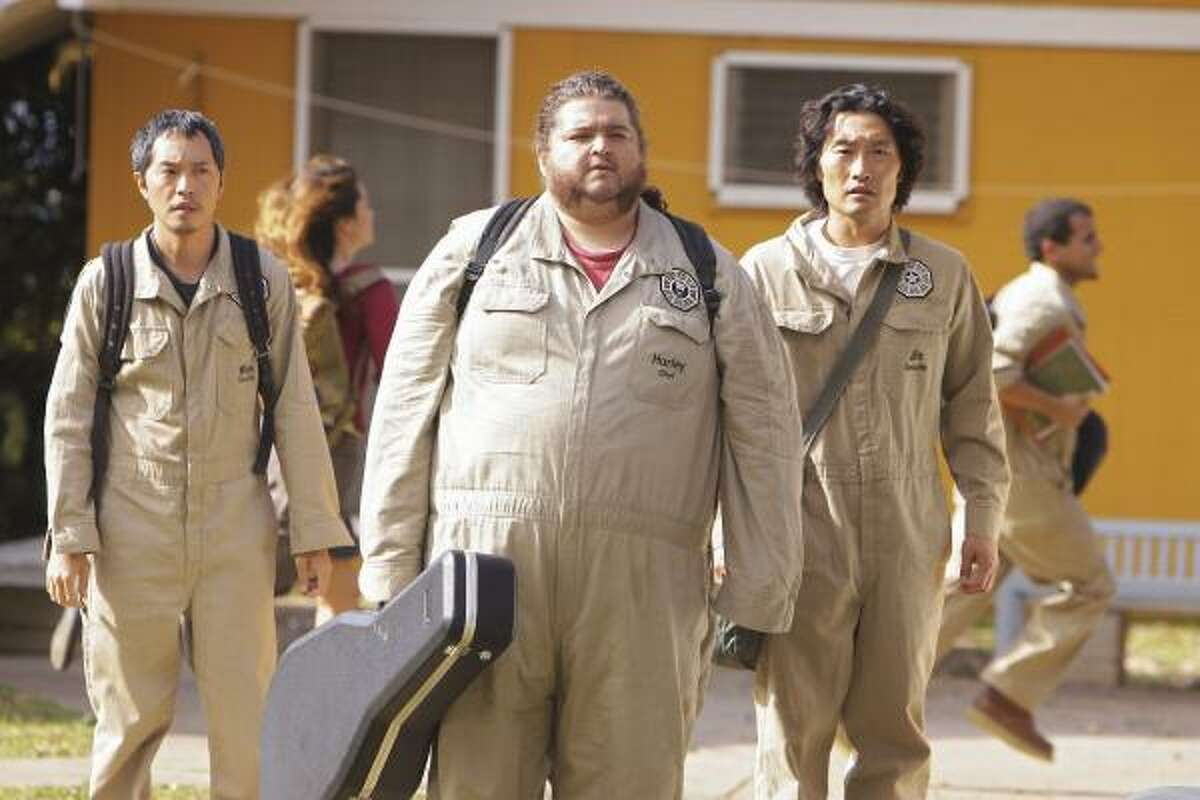 Ken Leung, from left, Jorge Garcia and Daniel Dae Kim are shown in a scene from the 100th episode of Lost, airing at 8 tonight.