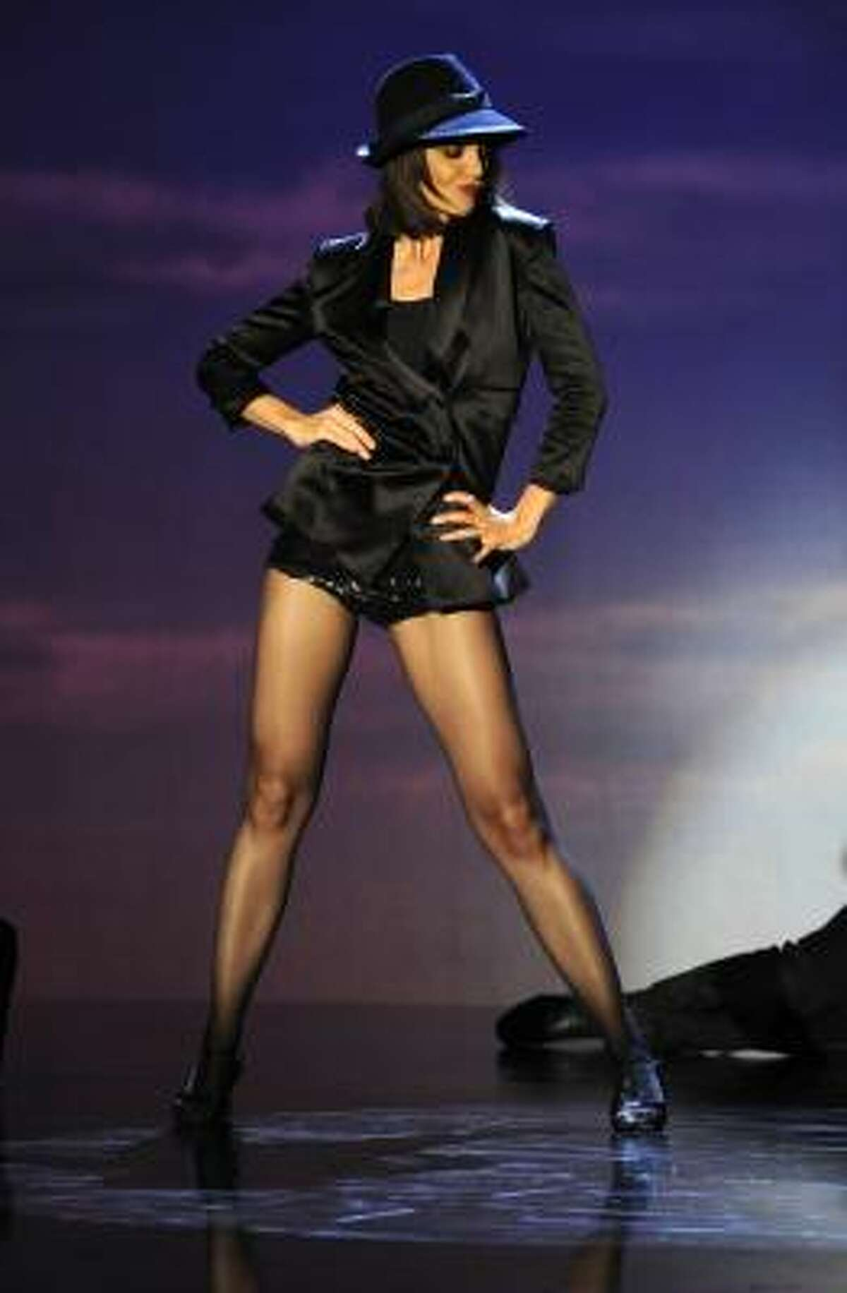 Dizzy Feet Foundation founding member Katie Holmes performs an homage to Judy Garland on the 100th episode of the dance competition show,
