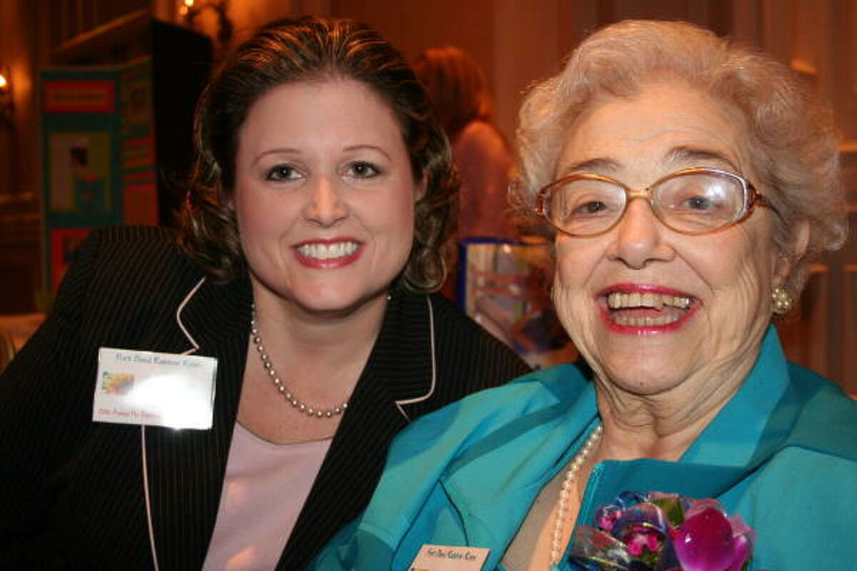 Wende Lewis-Buckley, left, board member of Fort Bend Community Partners Rainbow Room, visits with civic leader Flo Berkman.
