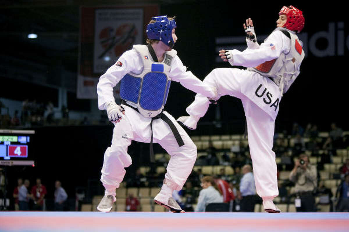 Steven Lopez, right, of Sugar Land, broke new ground with a fifth taekwondo world championship.