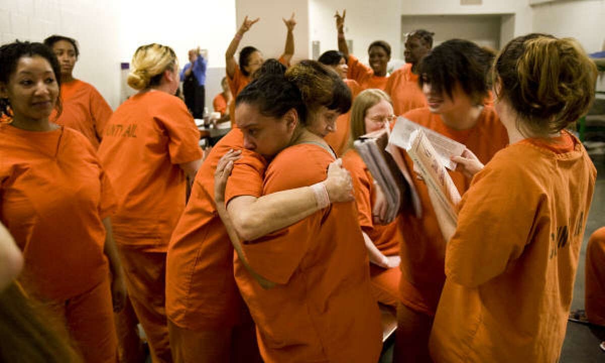 Marie Gonzalez, center, gets support from another inmate after a recent drug therapy session at the Harris County Jail.