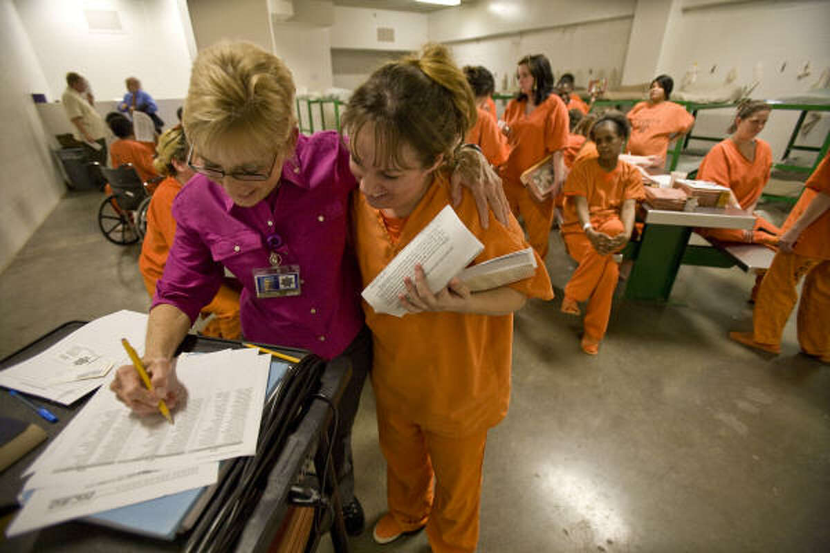 """Beverly Burke, left, of the New Choices program gets a hug from Jennifer McGuire after a therapy session. Burke calls the women in the jail program the """"Huggy Thug"""" group."""