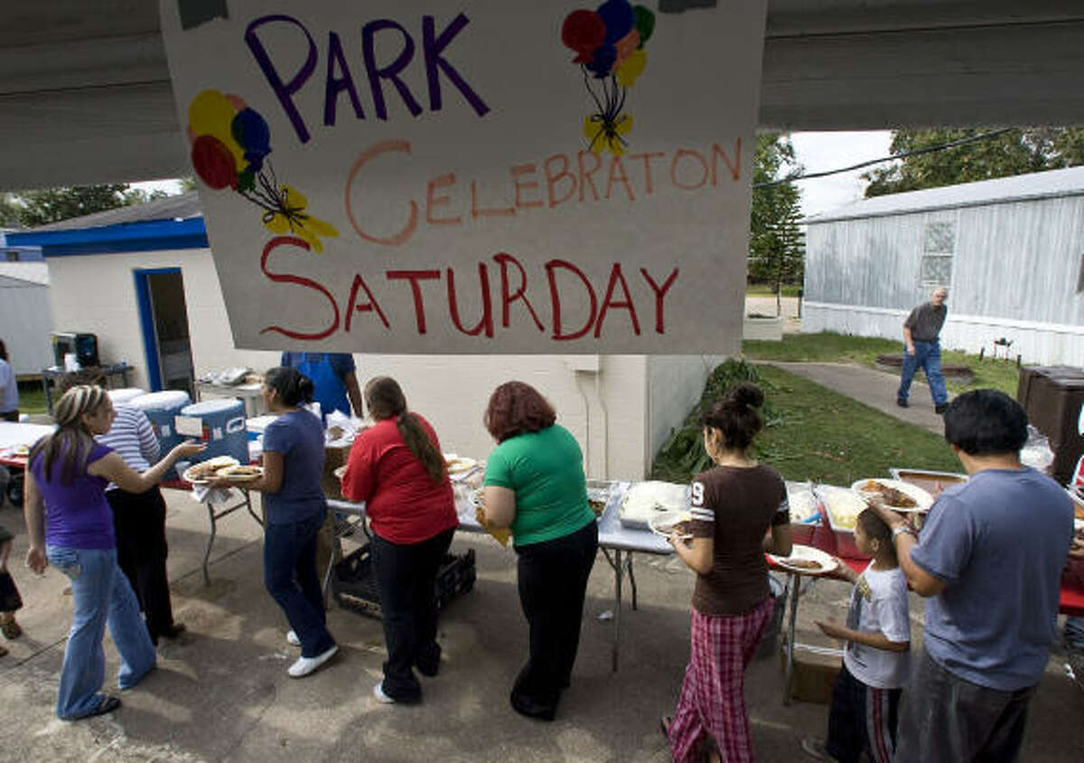 Residents of the Pasadena Trails mobile home park mark becoming the owners of their property with a catered barbecue lunch on Saturday.