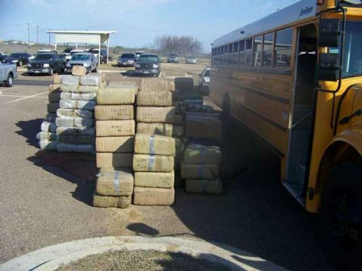 The DPS says 560 bundles of marijuana, valued at almost $4 million, were found packed into the school bus.