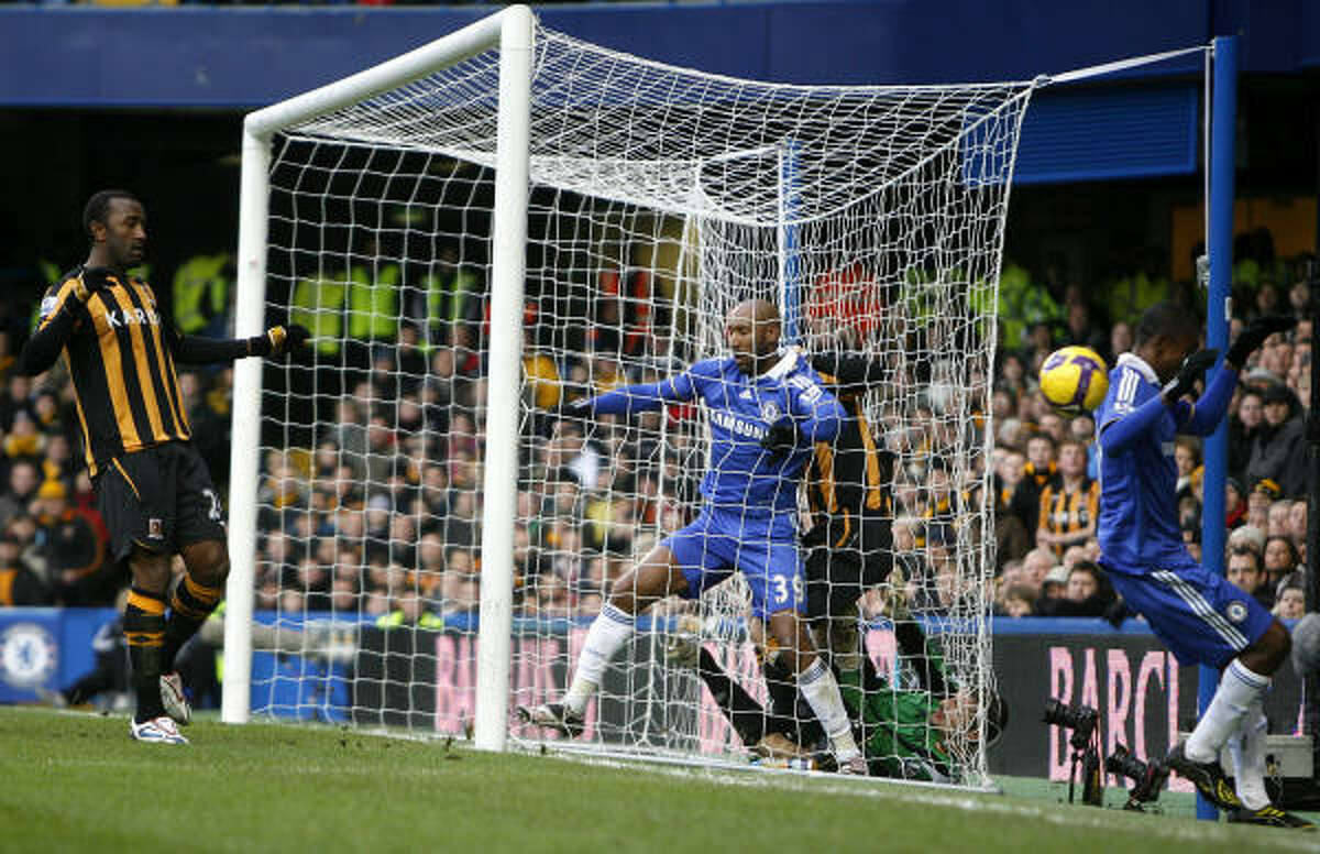 Chelsea's Nicolas Anelka, center, and Salomon Kalou, right, react after missing a chance to score as Hull City's Kamil Zayatte, left, looks on at Stamford Bridge stadium in London, Saturday.