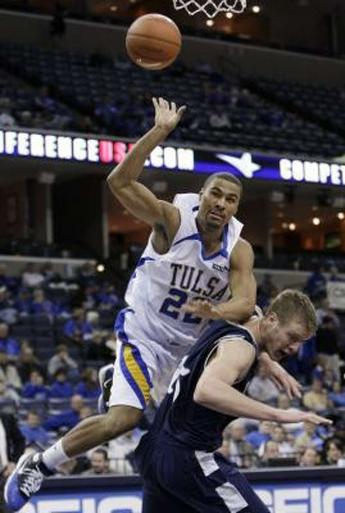 It was that kind of day for the Owls as Tulsa guard Glenn Andrews collides with center Trey Stanton in Thursday's Conference USA second round contest.