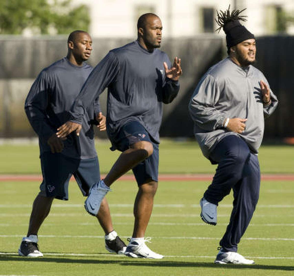 Texans defensive end Mario Williams, center, led the team with 12 sacks last season.