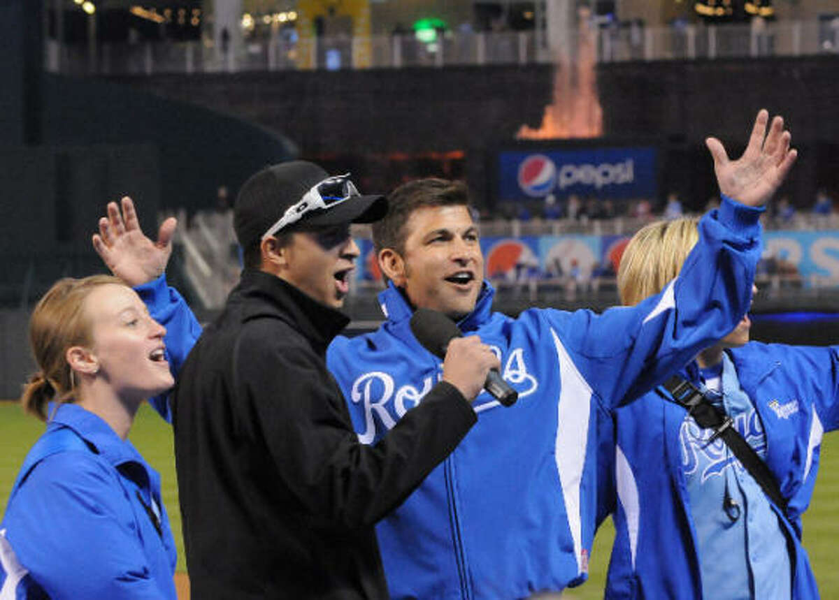 Camping World Trucks Series drivers Chase Austin, left, and David Starr threw out the first pitch and sang Take Me Out to the Ball Game at a Kansas City Royals game last week.