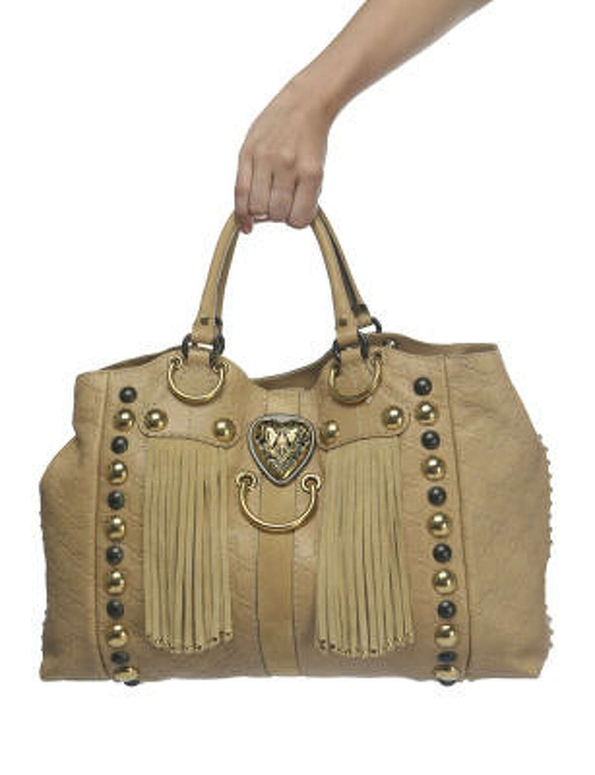 A suede, leather, fringed and embellished handbag by Gucci, $2,395.