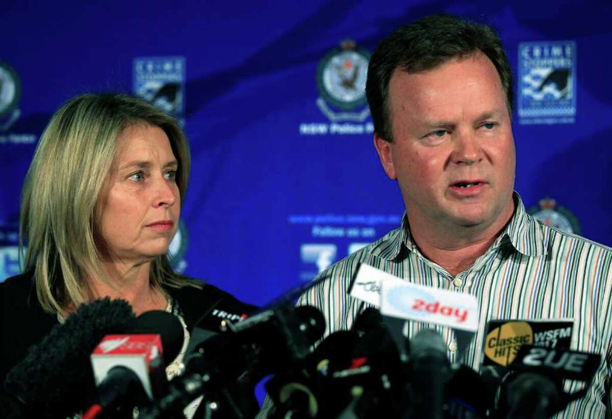 William Pulver, right, makes a statement as his wife Belinda listens in Sydney, Thursday, Aug. 4, 2011, a day after their daughter Madeleine was chained to a fake bomb for 10 hours. Australian police said Thursday they believe a masked man broke into the home of the wealthy Sydney family, chained the fake bomb to the teenage girl's neck and left a note of demands behind as part of an elaborate extortion attempt that seemed straight out of a Hollywood thriller. (AP Photo/Rick Rycroft)