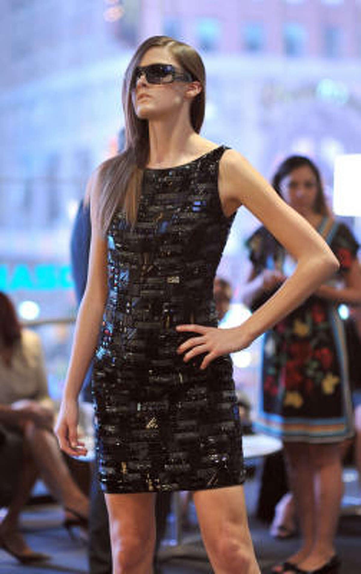 A Carmen Marc Valvo sheath for spring 2010 balances flattering, feminine lines with hard-core embellishments.
