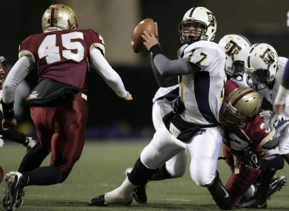 Cypress Woods defenders converge on Stoney Point quarterback Aaryn Sharp in the first quarter.