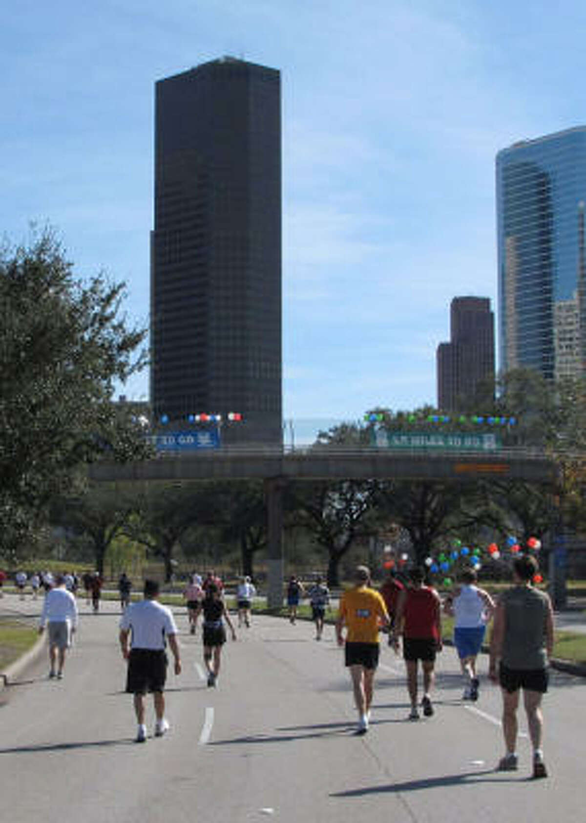 The race offered skyline views, including this one from Allen Parkway. By this point, a mile and a half from the finish line, many participants have slowed their pace.