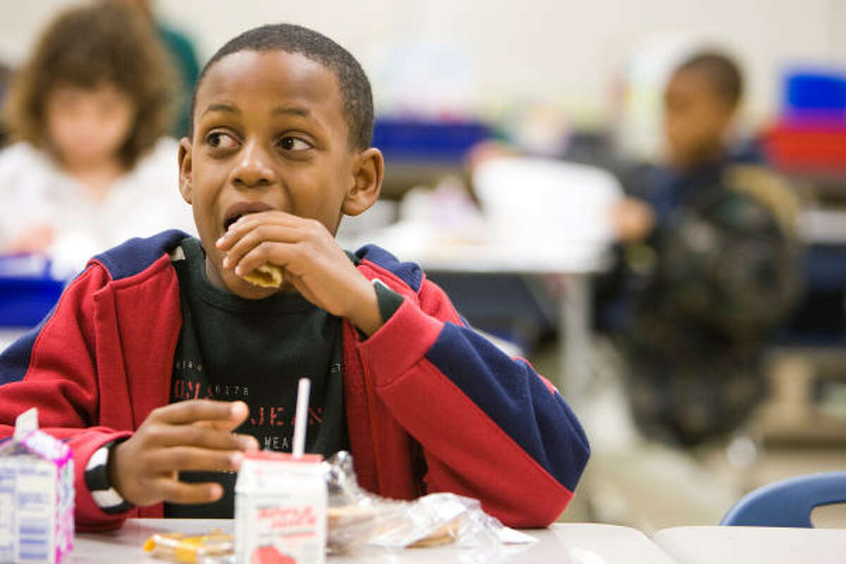 Kevin Canady, 9, a second-grader at HISD's Ruby Thompson Elementary, enjoys breakfast with his classmates on Friday.
