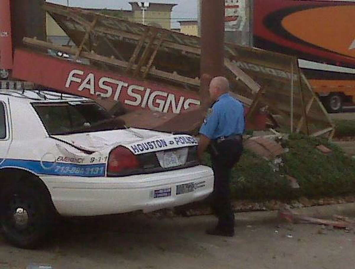 A Houston police officer crashed into a sign after going airborne from the I-45 northbound frontage road between Beltway 8 and Fuqua this morning.