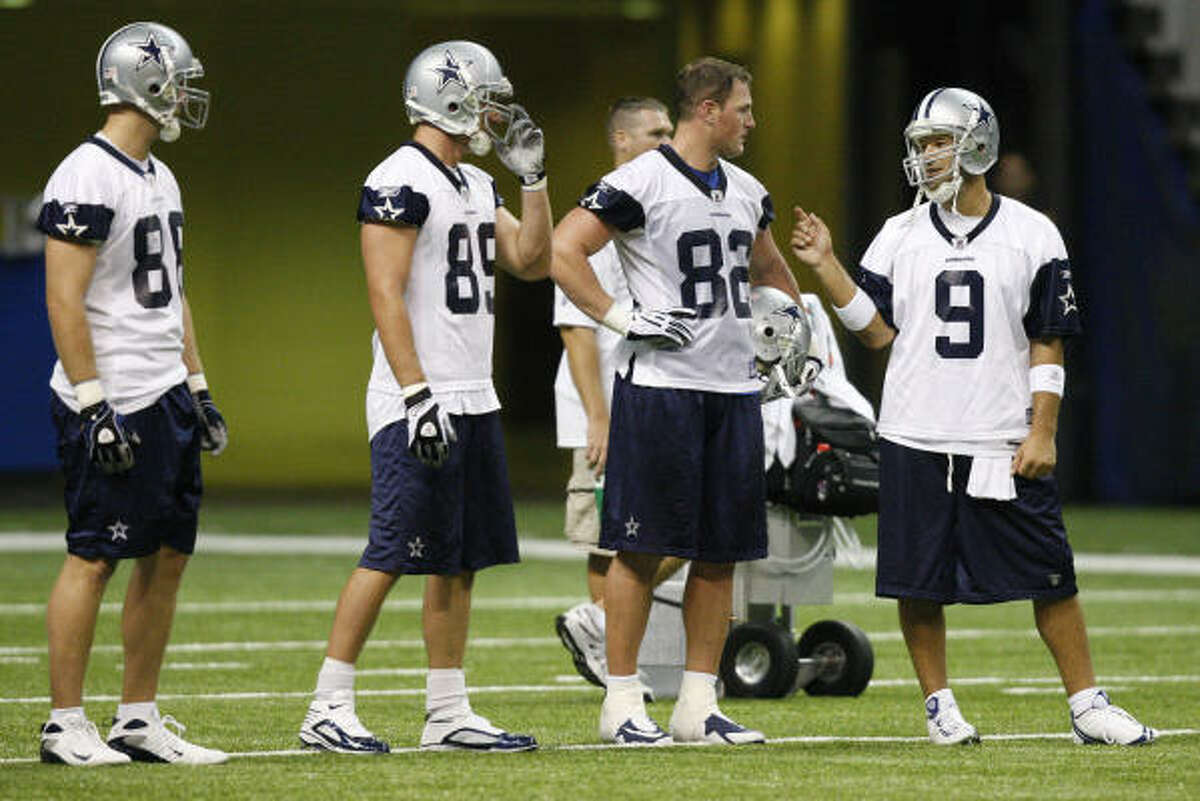 Cowboys quarterback Tony Romo knows he can turn to tight end Jason Witten, left, but he has several other offensive weapons at his disposal.