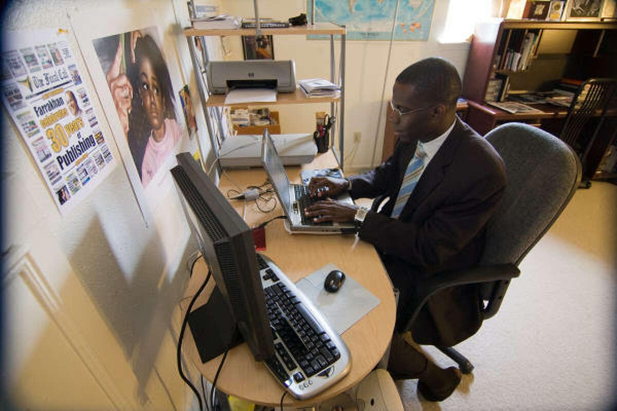 Jesse Muhammad, writer, journalist, speaker, and blogger, at work in his Missouri City office.