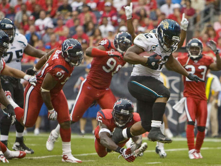 The Texans' defense has allowed well over 100 rushing yards to opposing running backs on the first three games of the season. Photo: James Nielsen, Chronicle