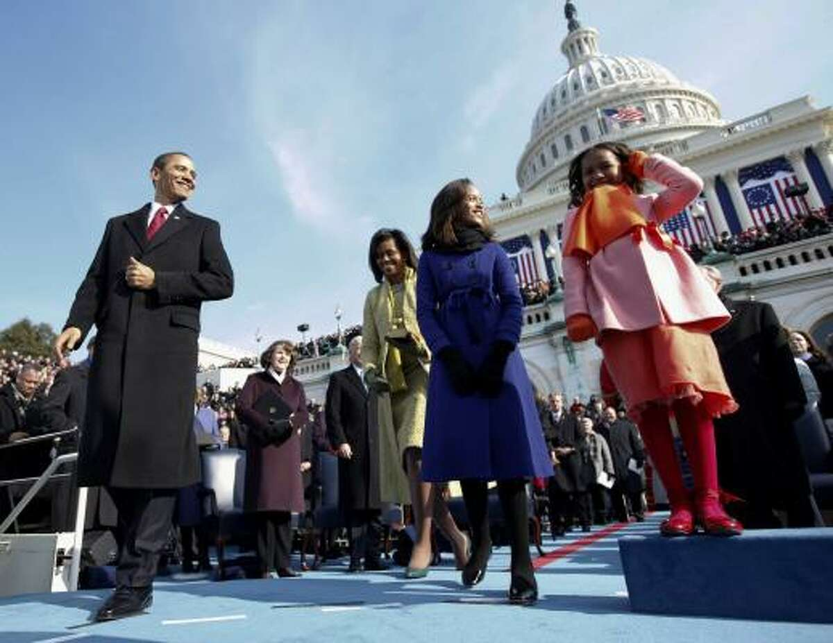 President-elect Barack Obama, left, and wife Michelle and daughters Sasha, right and Malia, are seen on the podium moments before Obama was sworn in as the 44th president.