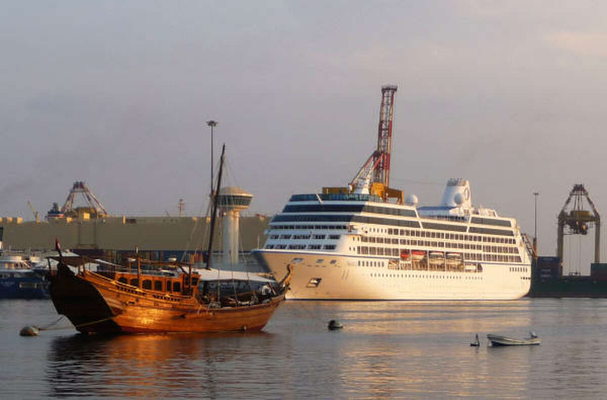 The 600-foot long M/S Nautica, right, prepares for a daylong port stop in the Omani capital of Muscat.