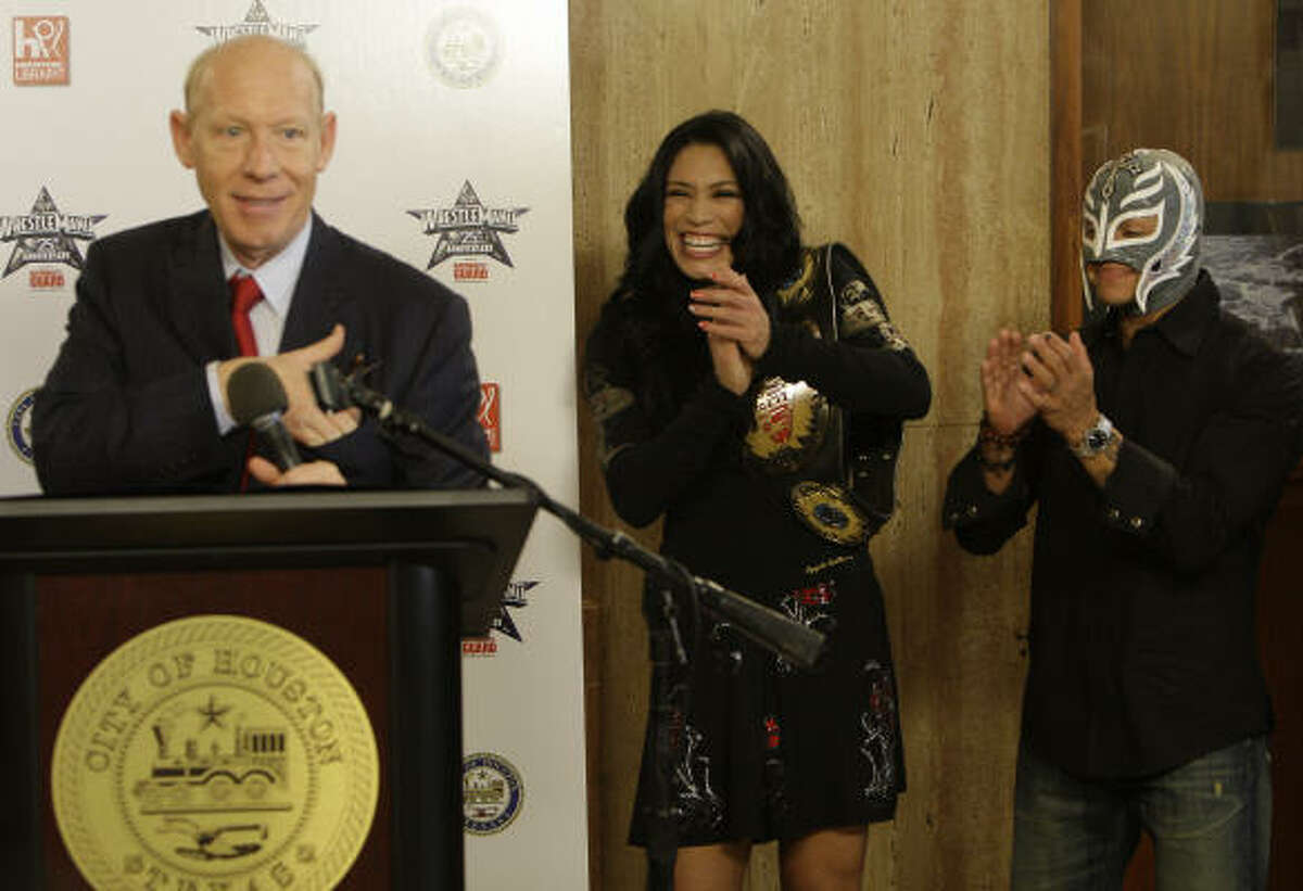 Houston Mayor Bill White holds a news conference on Tuesday with WWE diva Melina and WWE star Rey Mysterio.