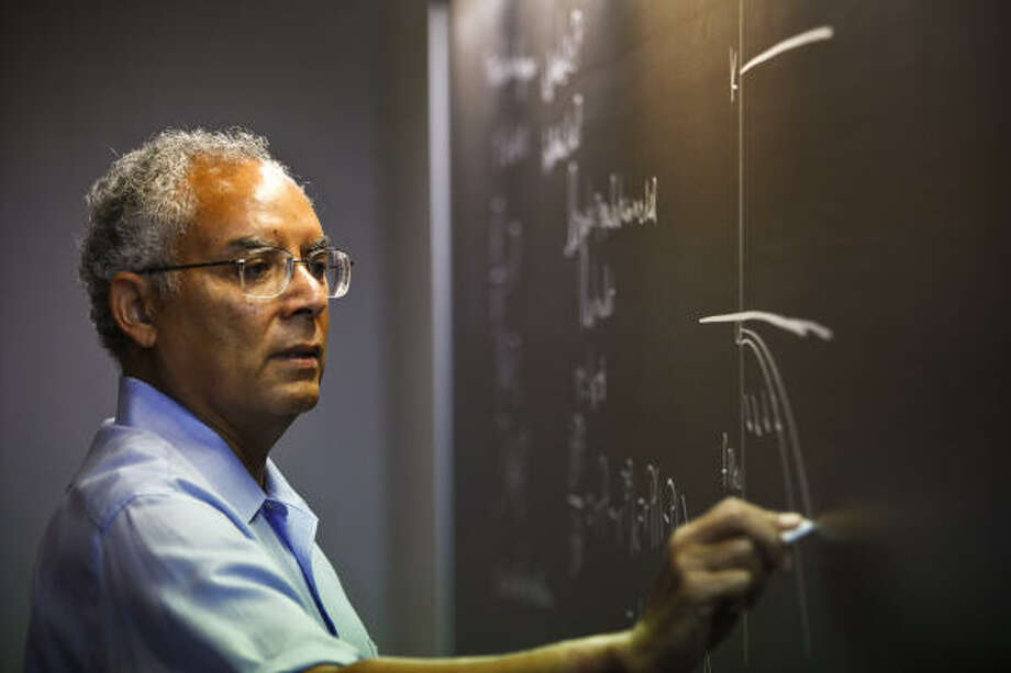 Raymond Johnson teaches differential equations at Rice University. He was the first African-American to attend, receiving his doctorate in 1969. Photo: Michael Paulsen, Chronicle