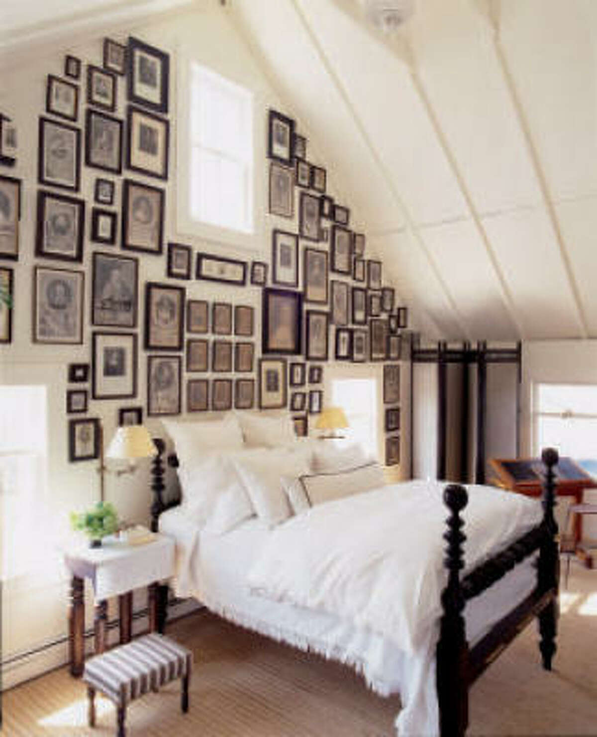 TOP OF THE STAIRS SURPRISE: Scores of British royals' portraits enliven an attic bedroom.