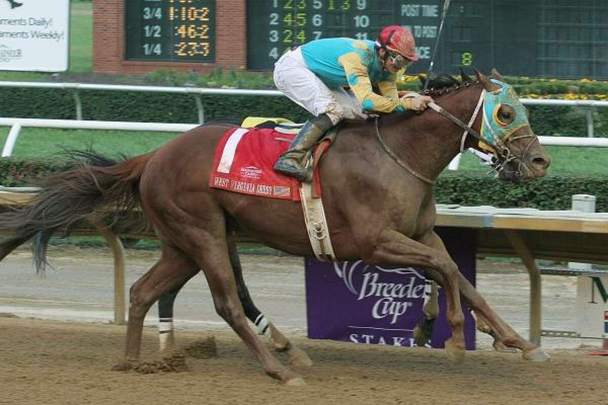 Jockey Dale Beckner rides Soul Warrior to victory in the West Virginia Derby.