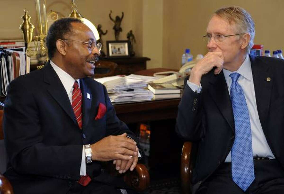 Illinois U.S. Senate appointee Roland Burris, left, meets with Senate Majority Leader Harry Reid of Nevada today in Washington.