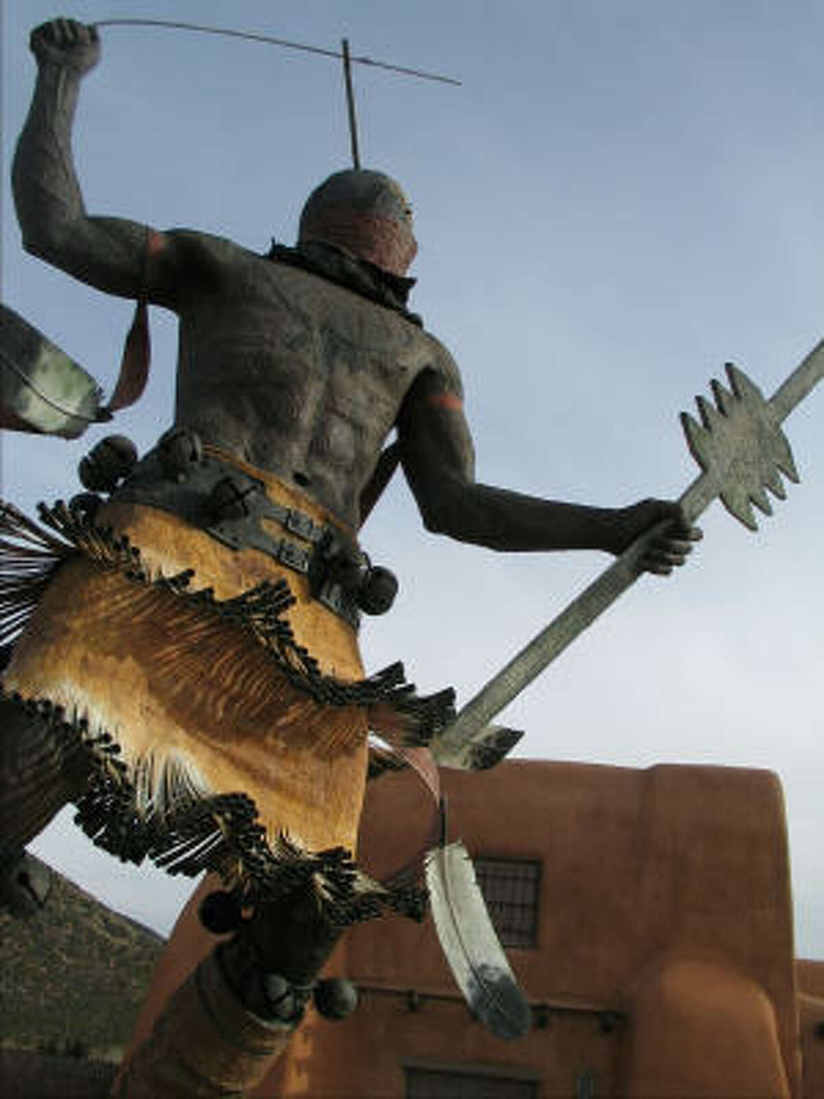 This sculpture of an Indian stands outside the Museum of Indian Arts and Culture in Santa Fe.