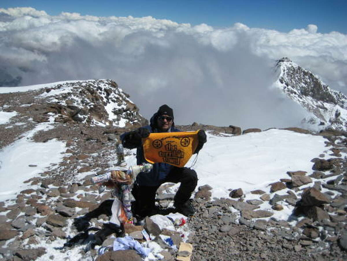 Greg Klovanich at the Aconcagua summit of the Americas, 22,841 feet.