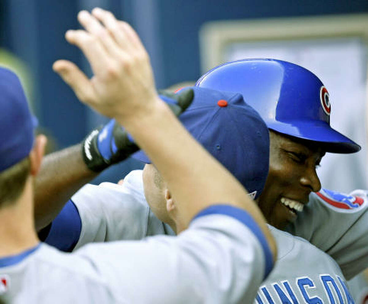 Chicago Cubs' Alfonso Soriano, right, hugs Reed Johnson after hitting a solo home run in the first inning against the Atlanta Braves on Tuesday in Atlanta.