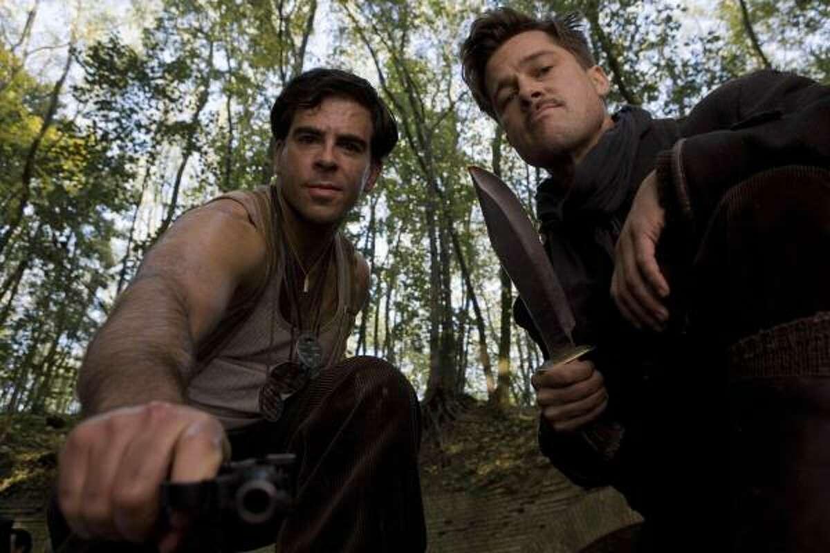Brad Pitt, right, and Eli Roth star in