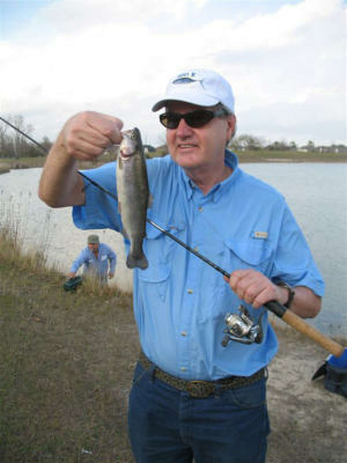 Dr. William Mathis shows a typical rainbow trout caught last week from Tom Bass III Lake in southeast Houston.