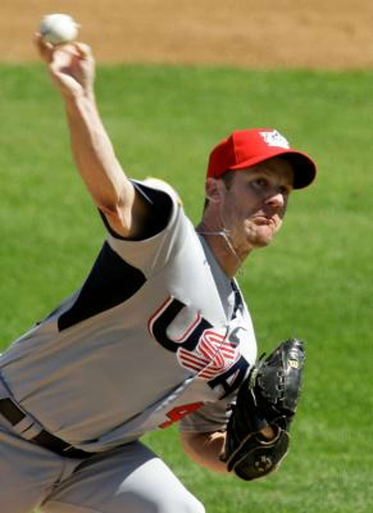 United States pitcher Roy Oswalt throws in the first inning against the Yankees.