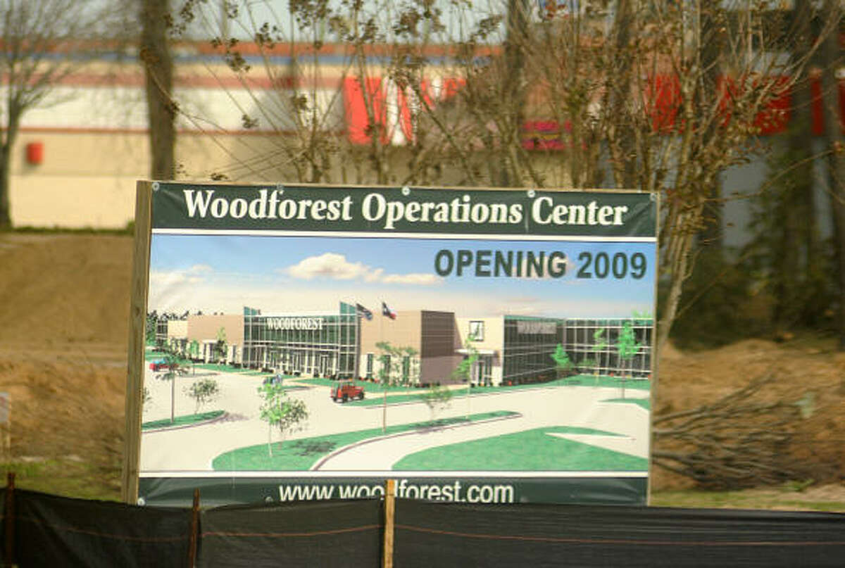 A sign in front of the new Woodforest Bank Operations Center at the old Wal-Mart center on Sawdust and Grogan's Mill.