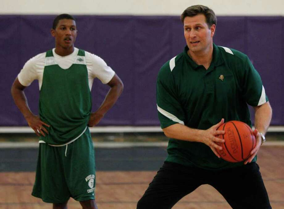 The Woodlands Christian Academy player Todd Eaglin, a junior, left, with interim head basketball coach, Reid Gettys, right, during practice Monday, Feb. 28, 2011 in The Woodlands. Reid Gettys, was a member of Phi Slamma Jamma at U.H. with Clyde Drexler and Hakeem  Olajuwan. TWCA is preparing this week to play in the state semifinals. ( Melissa Phillip / Houston Chronicle ) Photo: Melissa Phillip, Staff / Houston Chronicle