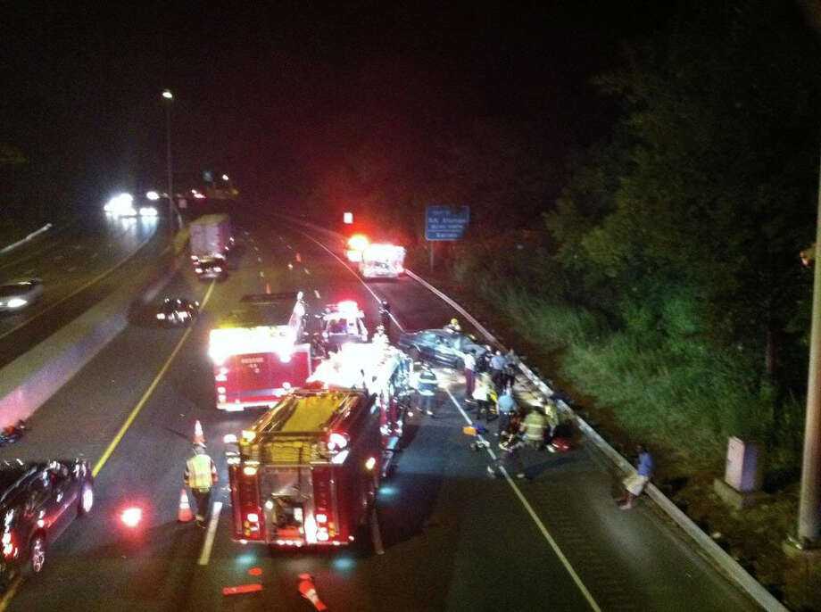 Police responded to a motor vehicle accident on I-95 North at exit 10 at about 8:45 Thursday night. Police said one male was transported to the hospital. Photo by Kristen Riolo for the Darien News. Photo: Contributed Photo