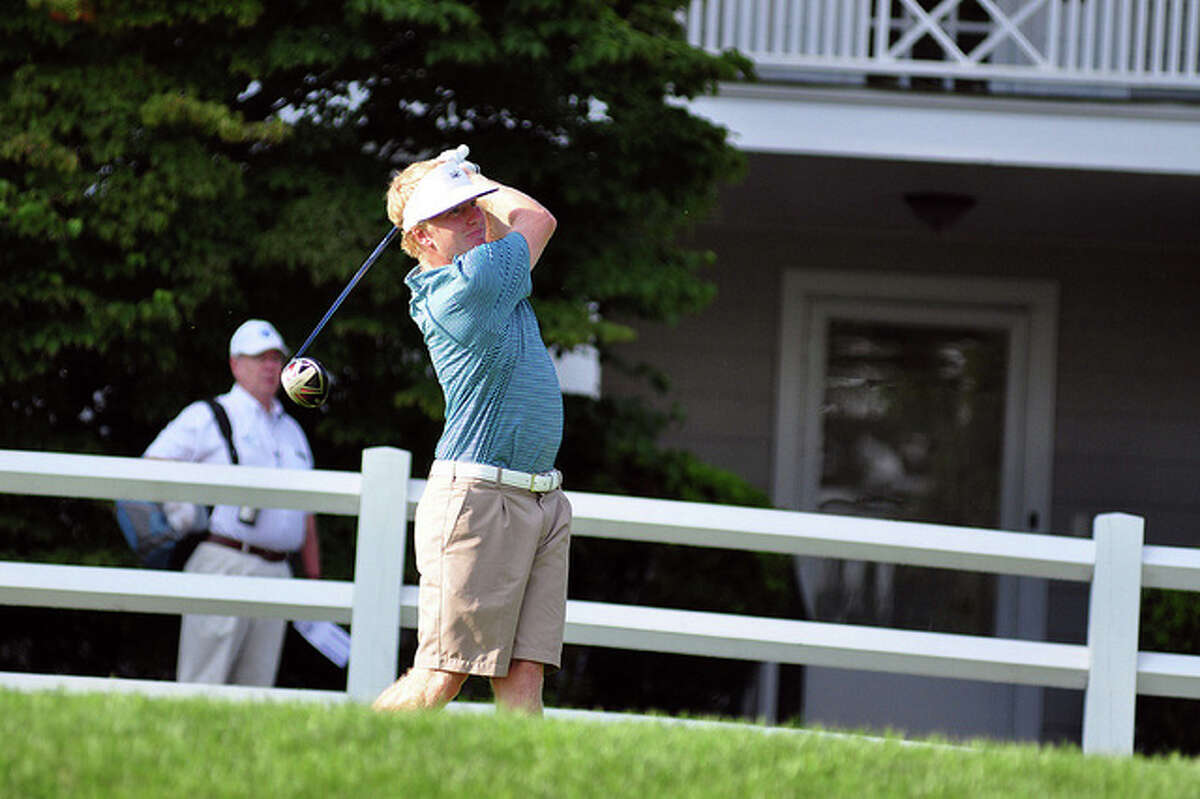 Shorehaven's Tommy McDonough watches his tee shot during the MGA Met Amateur Thursday at Piping Rock in Locust Valley, N.Y.