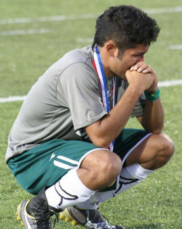 Brenham's Luis Lopez can't stop the tearsb from falling after he and his teammates lost to Hidalgo Early College, 3-2, in the Class 4A state semifinal. Photo: Gerald James, For The Chronicle