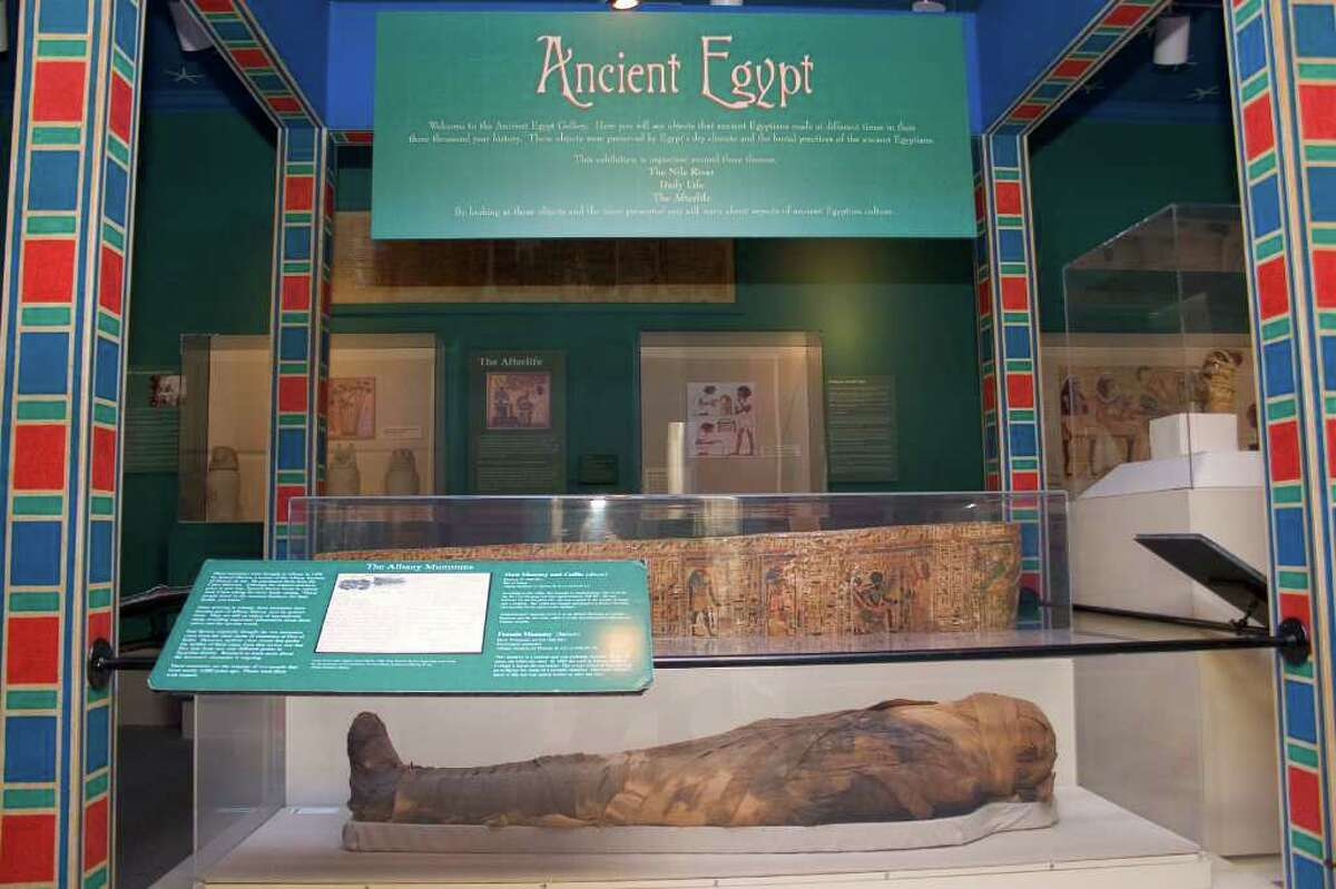"""Photo shows one of the mummies and coffin -- coffin is above mummy in separate case -- in the Albany Institute of History & Art's collection. They'll be featured in a 2013 exhibition on Egypt, """"From the Nile to the Hudson."""" (Photo courtesy of Albany Institute of History & Art)"""