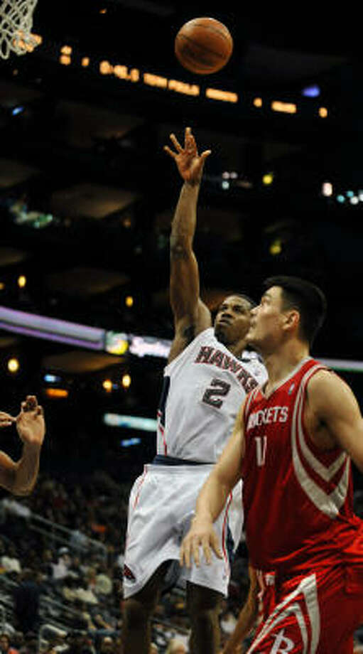 Hawks guard Joe Johnson (2) shoots over Yao Ming in the second quarter. Photo: Gregory Smith, AP