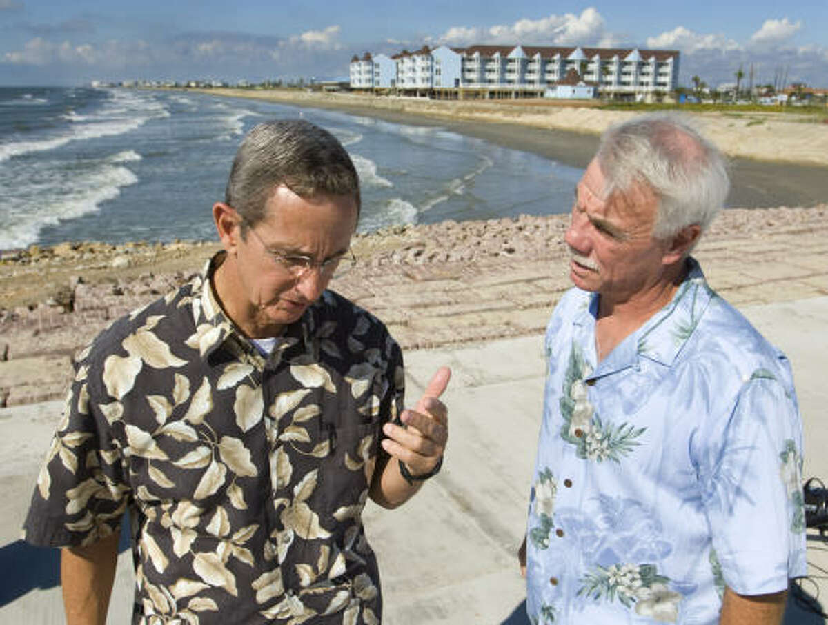 Texas Land Commisioner Jerry Patterson, left, talks with Galveston Mayor Pro-Tem Danny Weber after a news conference announcing the projects to rebuild Texas beaches.