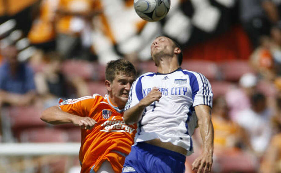 Bobby Boswell, left, signed a long-term deal with the Dynamo after exploring his options in Europe. Photo: Julio Cortez, Houston Chronicle